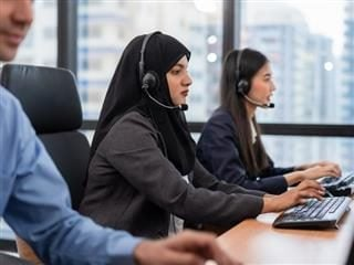 Call center agents working side by side.