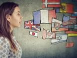 Illustration of a woman talking with numerous countries' flags to the right.