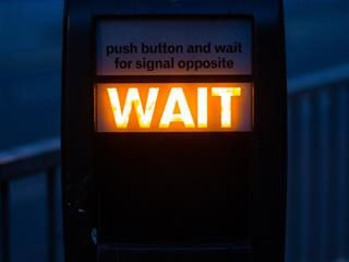 "walk signal lit to ""Wait"""