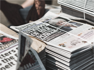 A stack of British newspapers on a street corner - Newsbyte concept