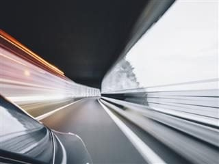 time lapse photo of a car moving fast on a road