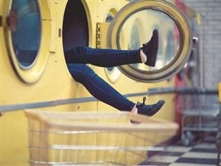 person in a washing machine