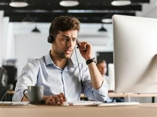 goofy stock photo of stereotypical stressed out customer service rep