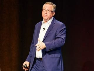 Scott Brinker on stage during his keynote at MarTech Conference East in Boston.