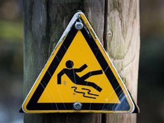 warning sign: slippery surface, tripping hazard