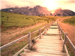 A wooden boardwalk in the country with a mountain in the background - Customer Journey Map Concept