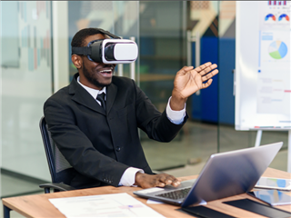 Portrait of young businessman in modern loft office wearing a virtual reality headset to attend in meeting in VR
