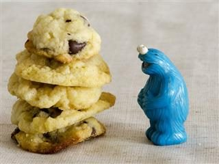 cookie monster staring at a stack of cookies