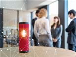 A smart speaker on the desk of a organization's conference room with people in the background having a discussion - Alexa vs Google Assistant Concept