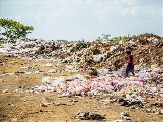 young boy walking through a garbage dump in Nicaragua