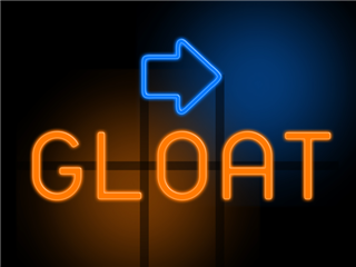 Orange glowing text that reads GLOAT, with an arrow next to it pointing to the right, on dark background