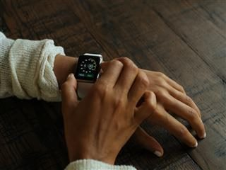 person with an Apple watch