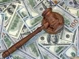 A judge's gavel sits across a pile of 100 dollar bills - EU fines Google