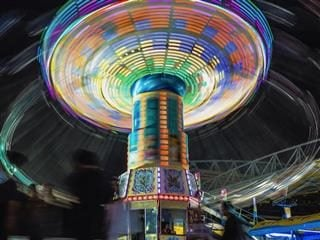 carnival  ride  at night, tilting on  its axis