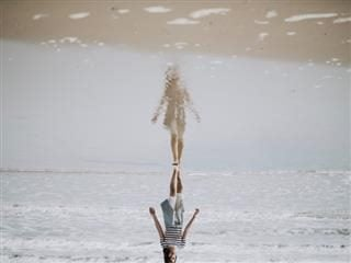 reflection flipped upside down/optical illusion of person walking on sand