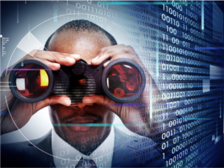 A businessman looking through binoculars for security threats with a technology concept background