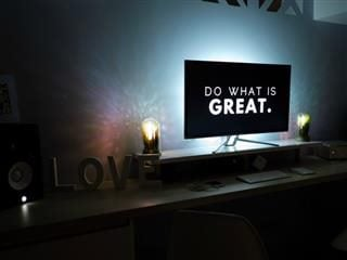 "words ""do what is great"" on computer screen"