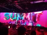 Steve Lucas on stage at 2019 Adobe Summit in background. Attendees in the foreground.