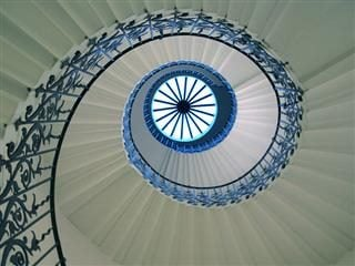 Howard view in the middle of a spiral staircase, creating an optical illusion.