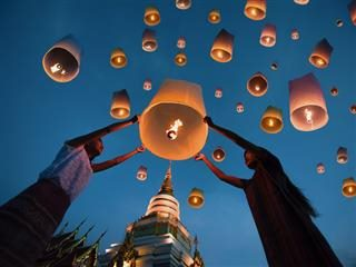 releasing paper lanterns into the air