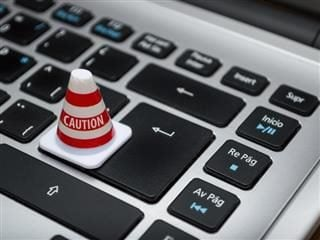 caution sign on a computer keyboard
