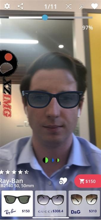 Pic of a man trying on virtually a pair of sunglasses to find his perfect fit.