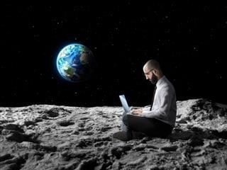 Office worker working remotely from the Moon's surface