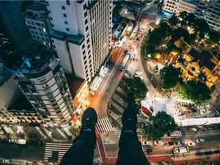 feet dangling from a skyscraper