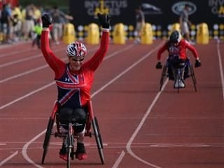 athlete in wheelchair on racing track