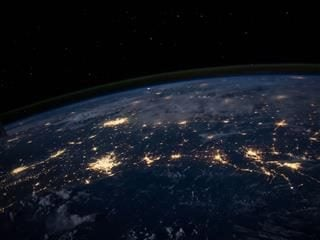 world from space with lights connecting across countries