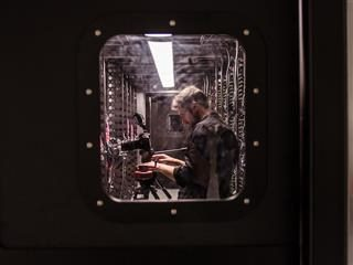 a photograph of a photographer at work in a data center