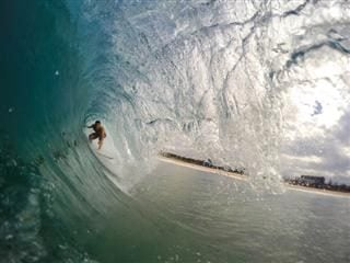 surfer riding in center of wave
