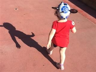 toddler walking at Disney World with Mickey Mouse ears on