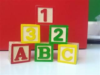 children's blocks in a stack: 1,2,3 and A,B,C