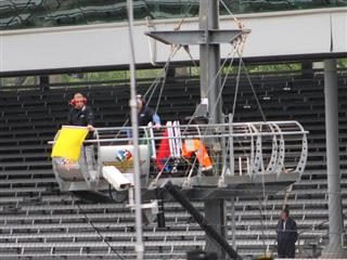The yellow flag is waved during Practice for the 100th Indianapolis 500 in May 2016.