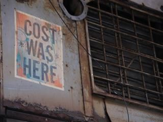 photograph of wheat paste graffiti by COST in NYC