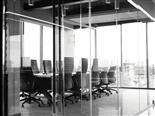 black and white shot of an empty conference room