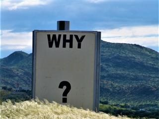 "sign with question ""why"" on top of a mountain"