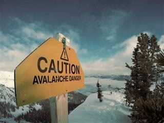 caution: avalanche risk sign