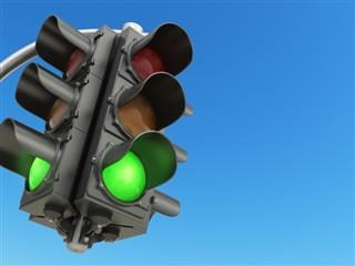 traffic light with green color on blue sky background