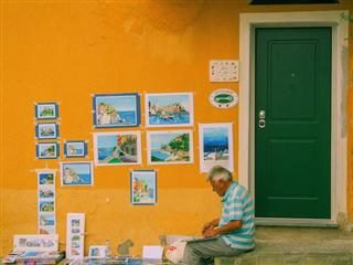 man painting  scenes of his area