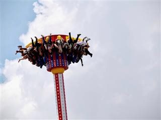 amusement park ride with people hanging upside down in the air