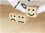 Artificial intelligence robot hand flipping the wooden satisfaction cube to choose happy customer.