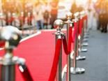 A red carpet guarded by a velvet rope at a theatre entrance - customer VIP concept