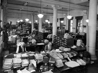 workers in an office in 1920