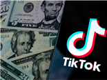 TikTok app logo on the smartphone screen and US dollar bills next to it.