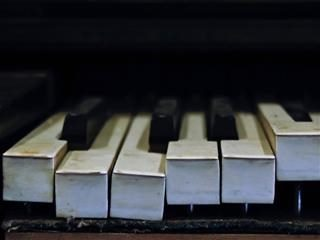 close up of broken piano keyboard