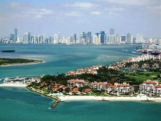 view of Miami and Fisher Island from 500 feet in the day time.