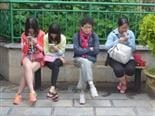 line up of women staring at their phones