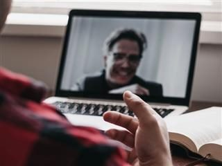 having  a  video chat, person on camera  laughing